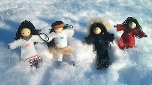 Dolls. Indian in snow